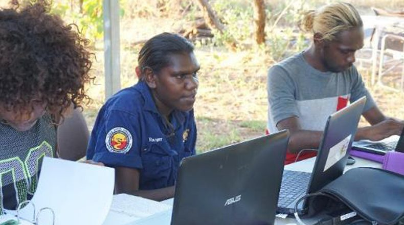 Image of IEK workers on computers in Arnhem Land