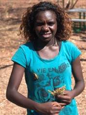Photo of Petria Lingiari with Leichhardt's Grasshopper on her chest
