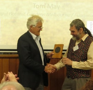 Photo of Tom May receiving 2014 Natural History Medallion