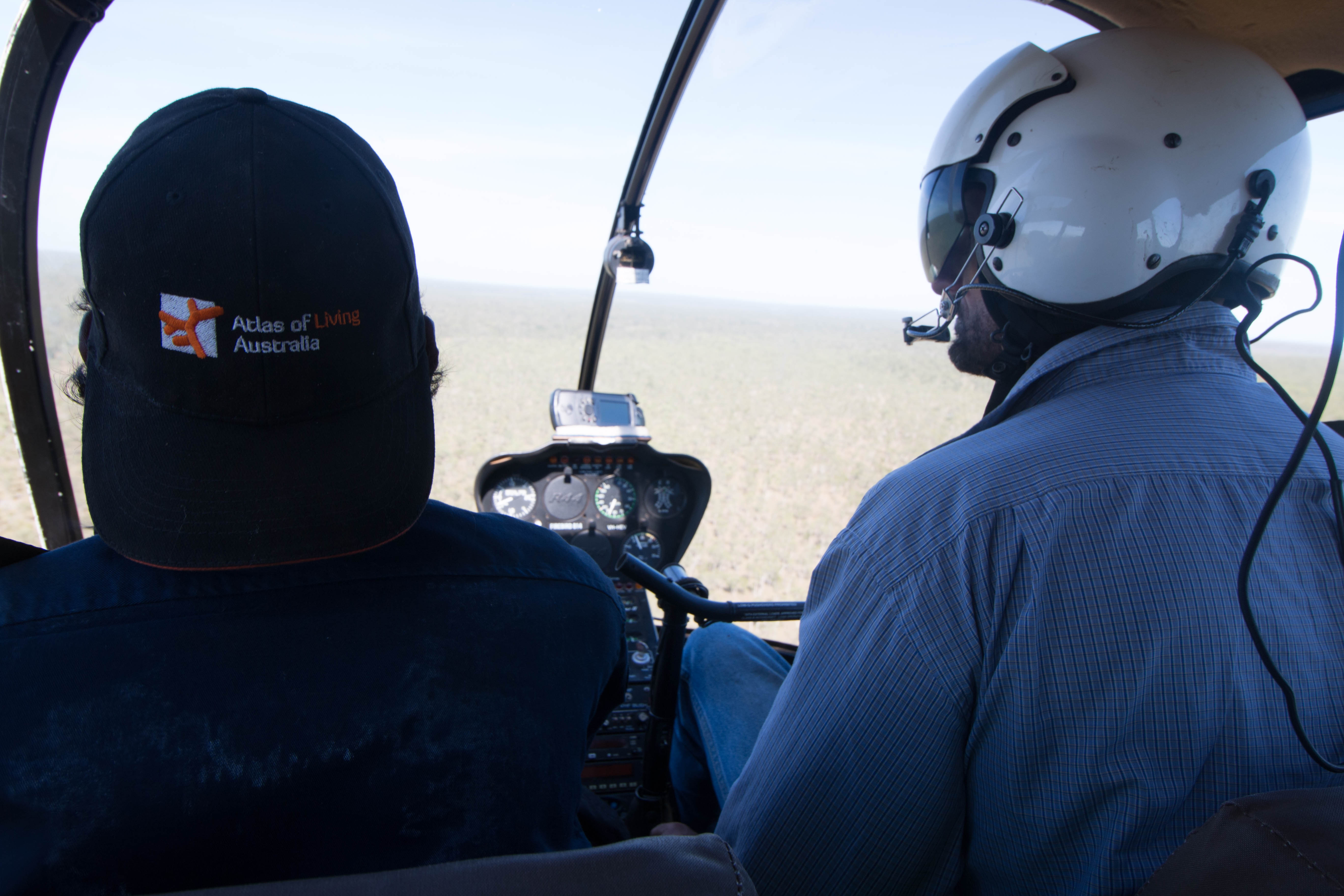Kelvin Rogers (Jungayi and Yugul Mangi Ranger) travelling over Ngandi Country with North Australian Helicopters pilot Luke O'Donnell.