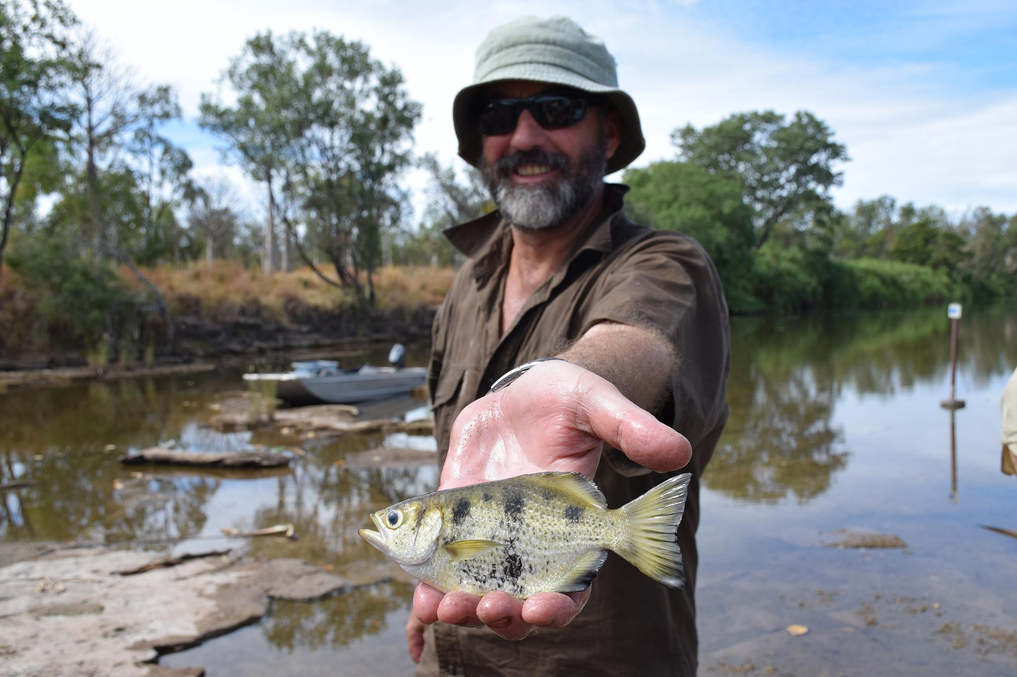 Gavin Dally holding an Archerfish